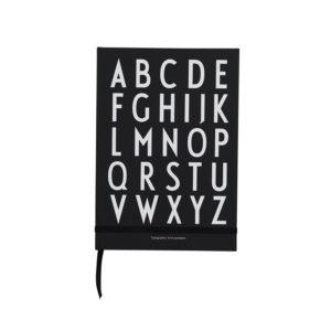 Zwart notaboek met alfabet van Design Letters
