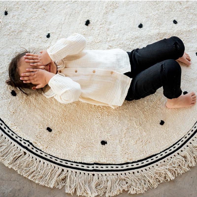 Wit rond tapijt van Tapis Petit